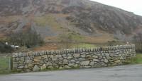 Random stone boundary wall